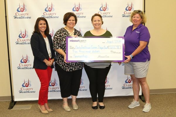 Representatives of Clarity Healthcare accepting the check presentation for the diaper bank are from left Christy Power, Vice-president; Amanda Wosman, Program Director; and Jacinda Epperson, Education and Outreach. On the right is Renee Hendrickson, Missouri Care Community Relations Specialist.