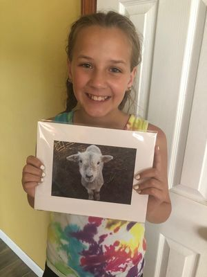 Marin Mallory holds her winning photo which is currently on display at the MO State Fair.