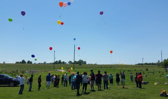 Balloons fill the air in tribute to those that have gone before.