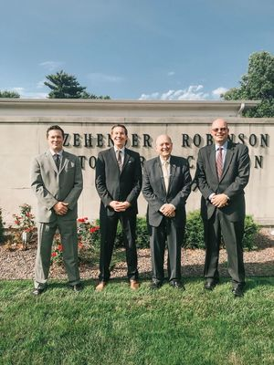 Caption for Photo: From left to right: Rory O'Donnell, General Manager with Jim O'Donnell President and owner stand next to Rod Cookson and Kyle Cookson in front of the Zehender-Robinson-Stormer-Cookson Funeral Home in Quincy.