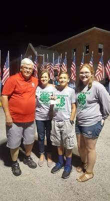 Liberty Wide Awake 4-H Club members were present for the return of the 55th Honor Flight on Saturday night, August 24th, to present a donation to help support the Honor Flight program.  Pictured are Dr. Mark Tucker, Honor Flight board member; Pam Barnes, leader of Liberty Wide Awake 4-H Club; Thomas Barnes and Samantha Barnes, both members of the club.  Dr. Tucker attended a club meeting to talk to the 4-H members about the Honor Flight program.  The 4-H members then held a Spaghetti Dinner with the proceeds to go to that program.