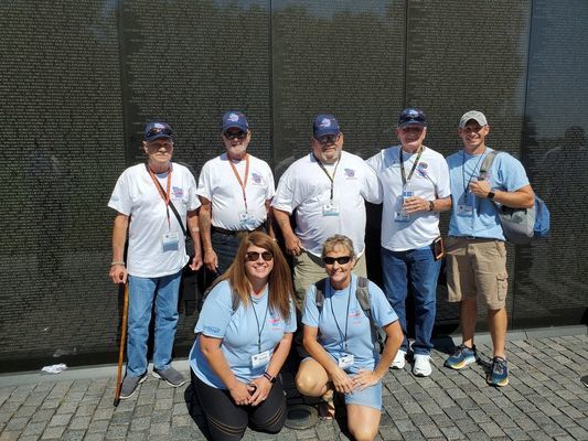 This picture was taken in front of the Vietnam Memorial. Front row guardians are Mandy McFarland of Hannibal and Sharon Lake of Center. Back row from left are veterans Chuck Widaman, Keith Payne, Henry Roush, John Booth, and Michael Copenhaver (Lake's son), guardian and 10-year Air Force veteran.