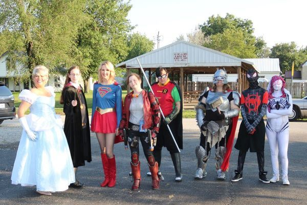 Superheroes visited the Center Park Thursday, Sept. 5, for a fun night sponsored by the Ralls County Library. Children ate hot dogs and ice cream, picked up their prizes for completing the Summer Reading Program and had their picture taken with their favorite superhero. From left are Cinderella, Hermione, Supergirl, Star Lord, Robin, Thor, Spiderman, and Ghost Spider.