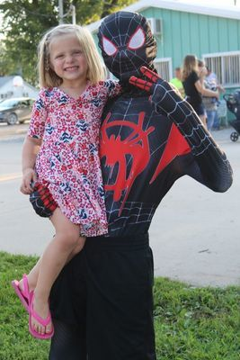 Krislin Evans, daughter of Greg and Kaylyn Evans, enjoys having her picture taken with Spiderman at the Superheroes Picnic.