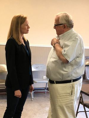 State Auditor Nicole Galloway speaks with John Briscoe after her speech Tuesday, September 10, in New London.