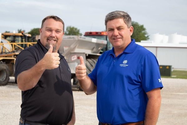 Attached Location Manager Ryan Houghton, left, is congratulated by Corteva Rep Ralph Nelson for winning a regional Environmental Respect Award for 2019.