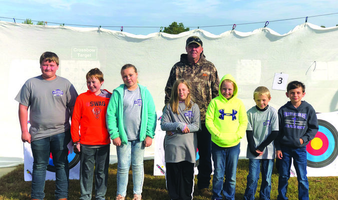 Pictured are PCA archers participating in the tournament - Anthony Duncan, Aiden Camden, Maddie Winner, Jenna Collins, Avalynn Camden, Jared Shuck, and Tanner Eisele with Coach Jim Anderson.