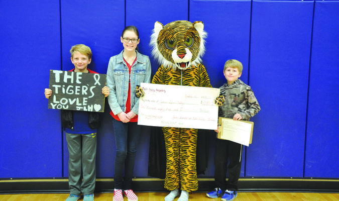 Pictured left to right:  Preston Dreisewerd, Jamie-Lynn Haley, Tiger mascot Kaylee Beckham, and Jackson Hathaway.
