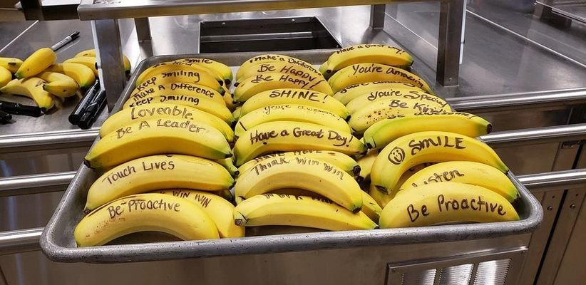 Pan of bananas with positive messages.