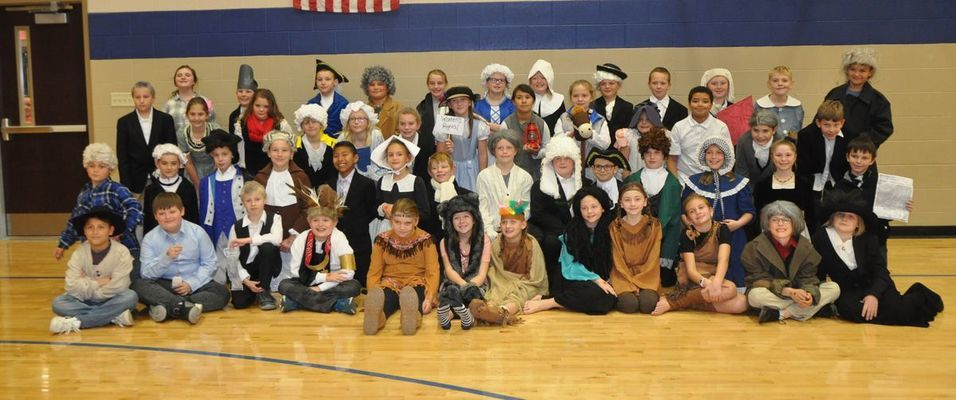 Entire 4th Grade class dressed for their Famous American Wax Museum