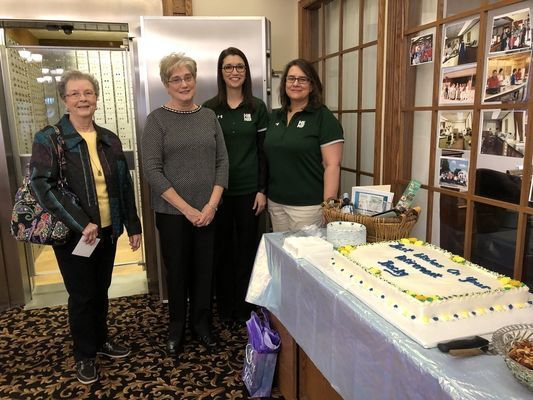 Becky Dunlap is shown with Carol Kirtlink, retired bank employee, and current employees Jill Palmer and Rachel Gilmore.