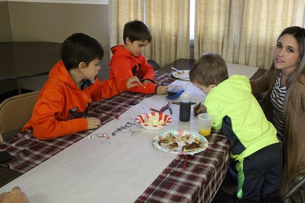 The Trantham boys color while eating breakfast with their parents (dad is out of camera view).
