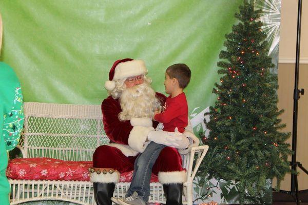 Santa listens intently to Caleb Shalosky.
