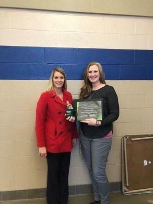 Dawn Snodgrass, right, with Ralls County RII Superintendent, Dr. Tara Lewis, receives her award from Kelly Services.