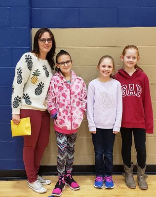 Megan Bergthold and Izzy Bergthold with Annabelle Roberts and Adelyn Conrad at RCE assembly.