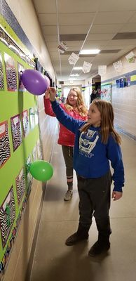Jesa Engle and Chloe Fierge get ready to pop their kindness balloons.