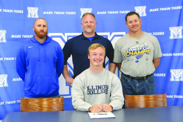 Jace Barton signed to play football for Illinois College in Jacksonville, Illinois. Pictured with Jace are his Mark Twain High School football coaches Jared Akright, Mark Epperson, and Karl Asbury.