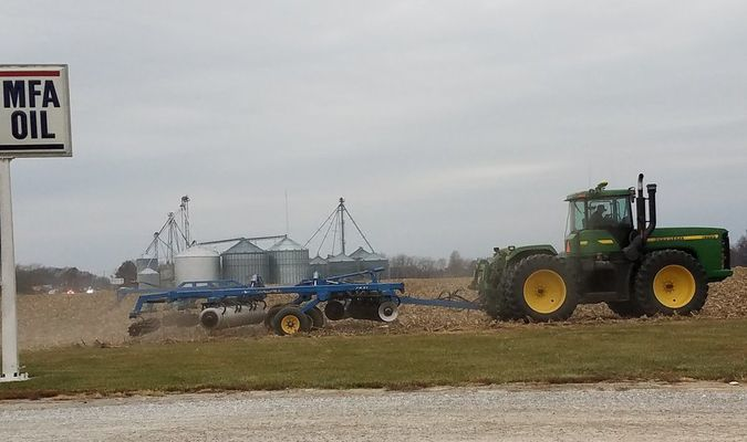 A farmer near Perry finishes field work in early December.