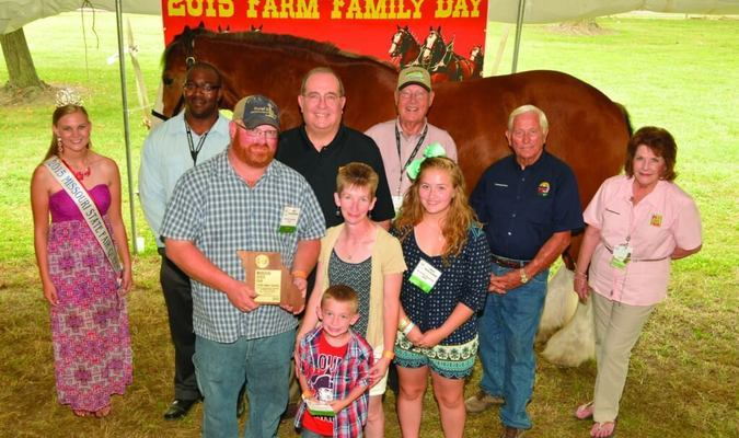 Front row from left are Ralls State Fair Farm Family, Jeremy, Melissa, Kennedy and Justin Jaspering. Back row from left are Destiny Reed, 2015 State Fair Queen; Darryl Chatman, Deputy Director Missouri State Fair; Dr. Thomas Henderson, Interim Vice Provost, Interim Director University of Missouri Extension; Dr. Jack Magruder, State Fair Commission; Lowell Mohler, Chair State Fair Commission; and Barbara Hayden, State Fair Commission.