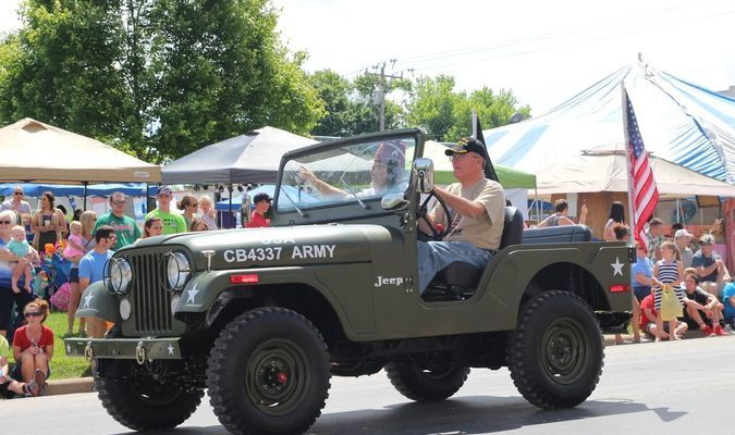Tom Day drives restored 1973 military jeep in the New London Park Days Parade