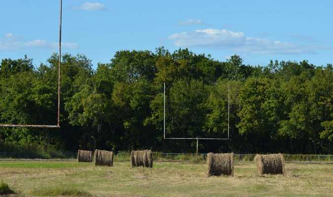 The dream of six-man football gracing the field of the Terrell Sports Complex may have been lost with the sale of the property, but don't tell the bales of hay. Nearly enough to make two teams were spotted practicing on the field between the goal posts this week.
