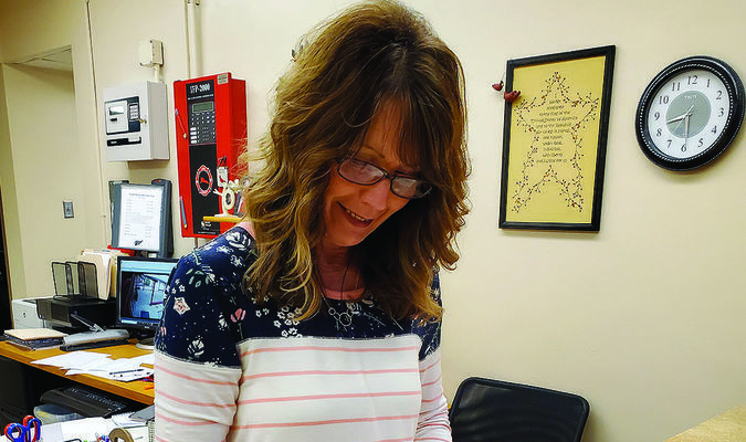 Kim McKenzie and the rest of the high school office staff have been making last minute preparations for the 2020 Commencement Ceremony that is scheduled for this weekend at South Shelby.                        Photo by Thad Requet, Shelbina Weekly