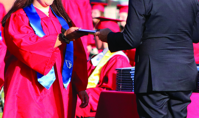 Sierra Fountain receives her diploma from Shelby County R-IV Board President Jim Foster during Saturday evening's commencement ceremony at South Shelby High School.                         Photo by Mark Requet, Shelbina Weekly