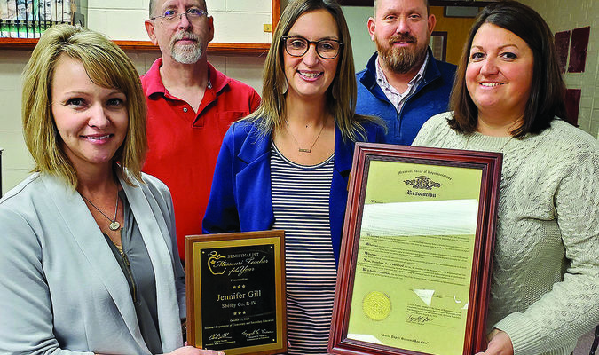 Jen Gill received recognition at the school board meeting for being a semifinalist for Teacher of the Year. Pictured above are (front row, left to right) Elementary Principal Katie Stueve, Gill and Assistant Principal Tara McWilliams. (Back row) Board President Jim Foster and Superintendent Troy Clawson.                         Photo by Thad Requet, Shelbina Weekly