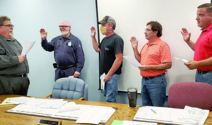 Pictured above is Shelbina City Clerk Tim Lacy swearing in three councilmen and the mayor. They are (from left to right) Lacy, Alan Denham, Chad Wharton, Mayor al Dimmitt and David Dovin.			Photo by Thad Requet, Shelbina Weekly