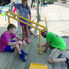 Several members of the Shelbina Christian Church Youth Group were out on Monday afternoon volunteering their time to help with some maintenance work for the City of Shelbina. Pictured above is Josiah Lootens, Micara Bode and Shelbina Christian Church Minister Mitchell Seaton painting hand rails.                        Photo by Mark Requet, Shelbina Weekly