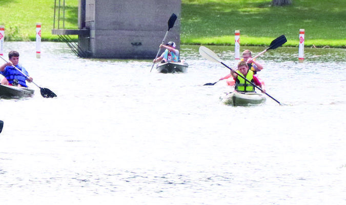The Kayak races were something new at the Shelbina Lake this year as part of the Fourth of July Celebration. People of all ages participated in the races.			              Photo by Mark Requet, Shelbina Weekly
