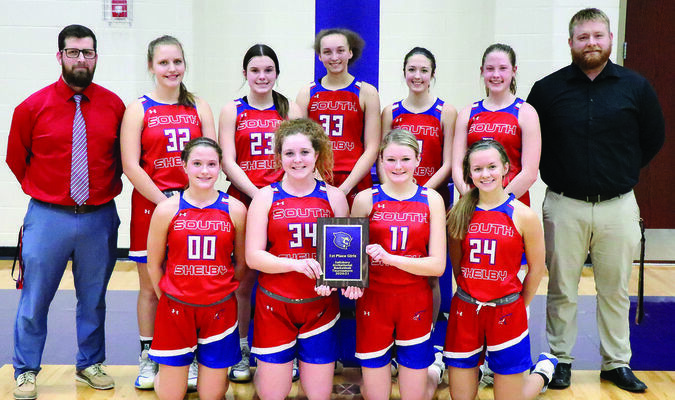 The South Shelby Lady Birds won the Salisbury Basketball Invitational Tournament, defeating the host squad Friday night. Pictured above (front row, left to right) are Hannah Wegman, Emma Dovin, Marisa Rubison and Kamryn Mitchell. (Back row) Head Coach Luke O'Laughlin, Clara Wood, Kaylee Gaines, Milli Mozee-Williams, Summer Hunolt, Miranda Patterson and Assistant Coach Adam Gunterman.