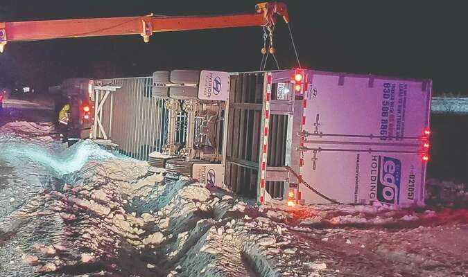 The driver of this semi-tractor trailer escaped injury on Thursday, Feb. 18 when he ran off the right side of US 36 and overturned on the east bound shoulder, about three miles east of Shelbina.	              Photo by Thad Requet, Shelbina Weekly