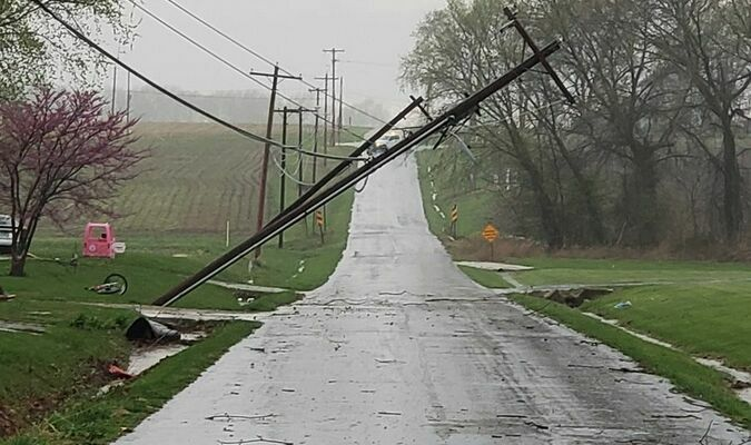 Power lines were snapped on the south side of West College across from the Shelbina Cemetery due to the high winds.  Photo by Thad Requet,  Shelbina Weekly