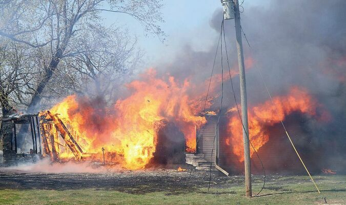 The Shelbina Fire Protection District responded to a house fire north of Lakenan on the afternoon of Wednesday, April 14. There was nobody home at the time of the blaze. The house was a total loss.		Photo by Mark Requet, Shelbina Weekly
