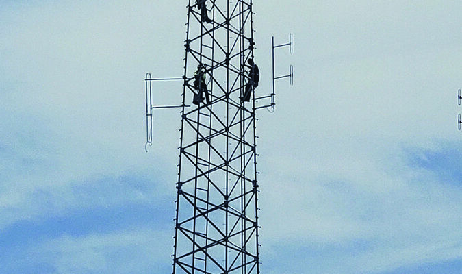 A new railroad communications tower is going up on the south side of the tracks,at the north edge of the Shelbina Senior Center parking lot. The tower is being installed by Hayden Tower Services out of Lenexa, Kan. The tower stands around 200 feet tall. Pictured above are four workers hanging from the tower working on the installation of its accessories.                         Photo by Thad Requet, Shelbina Weekly