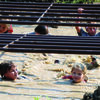 The Annual Firecracker Mud Run was one of the highlights of the two-day Fourth of July Celebration that was held at the Shelbina Lake. Pictured above are children making their way through the mud and water while ducking under cattle panels at one of the mud pits on the east side of the lake. Many of the events were lightly attended this year and a few of the scheduled events were cancelled because of wet conditions. The two-day celebration was capped with the annual fireworks display that was held Sunday night.              Photo by Mark Requet, Shelbina Weekly
