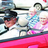 Gene and Pat Hatcher were the Grand Marshal's of the Shelbina Farmer's Day Parade on Saturday, Sept. 11. The Hatcher family owned and operated Hickey Drug Store for many years in downtown Shelbina and have been involved with the community for many years. Escorting them in the parade is Frank Ewart of Shelbina.Photo by Mark Requet, Shelbina Weekly
