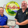 Shelbina City Marshal Jeff Brown received Risk Management grant for $1,100 from MIRMA representative Kelly Beets at the beginning of Tuesday evening's council meeting. The money will go for a tazer for the Shelbina Police Department.                                                                        Photo by Thad Requet, Shelbina Weekly
