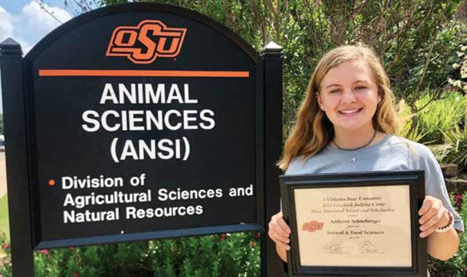 Carnegie freshman Addy Schneberger earned the 'Most Improved' honors and a $200 scholarship at the recent Oklahoma State University livestock judging competition.
