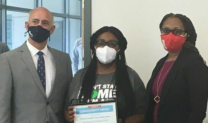 DHEC presents a Community Heroes award to Fetter Health Care Network in Charleston on March 30, 2021. From left to right are Taylor Lee, DHEC's Lowcountry Regional Health Director; Aretha Powers, Chief Executive Officer for Fetter Health Care Network; and Felicia Veasey, DHEC Community Systems Director for the Lowcountry