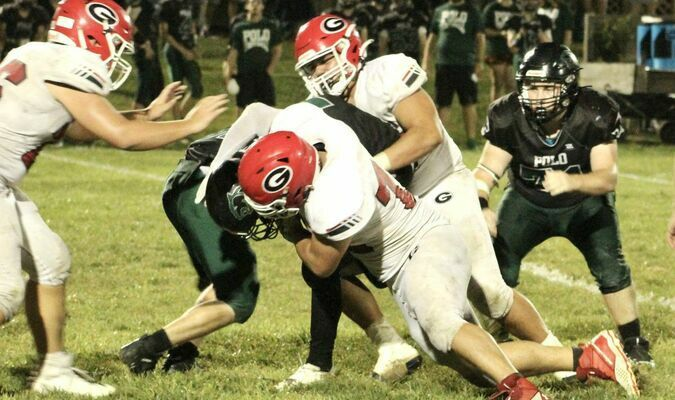 Carson Lang and Gabe Parker with the tackle against the Polo Panthers.