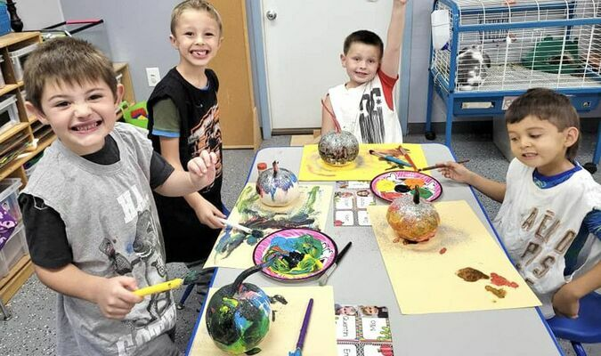 TC Elementary students who attended tutoring session this week painted and carved pumpkins and were able to work at stations in the class room.  Above, Jase Strouse, Zayne Hutchinson, Zander Ackley and Kamden King paint pumpkins.