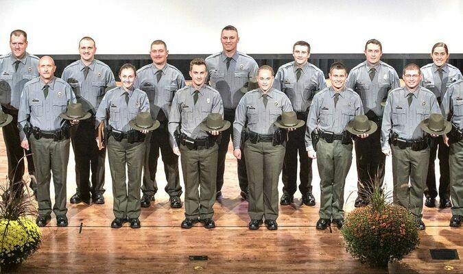 MDC congratulates 15 new conservation agents on their graduation from the 2021 Conservation Agent Training Academy. The new agents will 166 others in protecting Missouri's fish, forest, and wildlife. Pictured (L to R) Jacob Fisher, Christopher Barnes, Jeremy Caddick, Logan Brawley, Clarissa Lee, Aaron Burnett, Jaycob O'Hara, Nathan Ingle, Ashton Reuter, Payton Emery, Kristopher Smith, Donald Fessler, Dustin Snead, Jessica Filla, and Tex Rabenau.
