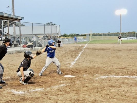 Michael Holtzclaw takes his turn at the plate.