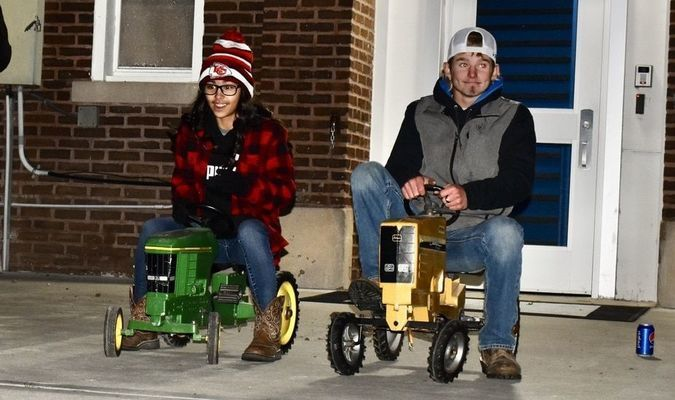 Tori Dunks and Kedrick Mooney get ready to start the pedal tractor race.