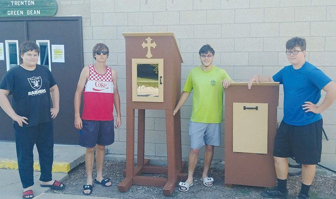 """Trenton Troop 39 members and helpers display the """"Blessing Boxes"""" engineered and designed by Eagle Scout Travis Woodall. Above from left: Carter Plute, Seth Woodall, Travis, and Tommy Plute."""