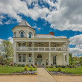 Grace-House-exterior-photo-on-business-card
