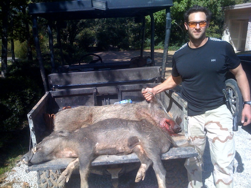Cade with two dead boars