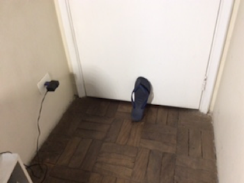 Shoe against door